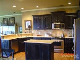 Black Corian Countertop Kitchen Black Cabinets With Corian Countertops Tumble Backsplash