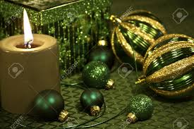 green and gold ornaments with ribbon on festive