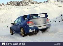 subaru winter subaru impreza 2 5 wrx sti model year 2005 blue moving
