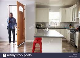 coming home interiors man coming home from work and opening door of apartment stock
