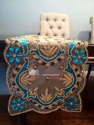 hand beaded turquoise and gold embroidered and sequined with