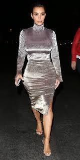 kim kardashian shines in a figure hugging turtleneck dress