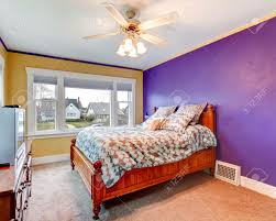 Light Yellow Bedroom Walls by Bright Bedroom With Purple And Yellow Walls Carpet Floor