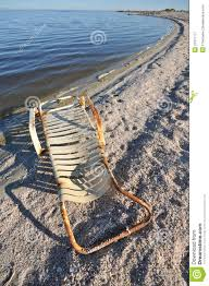 rusted old lounge chair by the salton sea royalty free stock