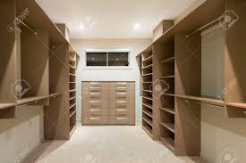big empty walk in wardrobe in luxurious house stock photo picture