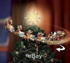 revolving tree topper santa reindeer sleigh light