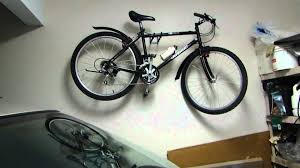 easy way to hang your bike in a garage without a rack or pulley