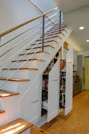 11 great storage ideas for the wasted space beneath your stairs