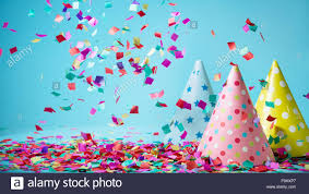 party confetti colored confetti and party hat on blue background stock photo