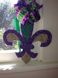 mardi gras fleur de lis made with mardi gras beads repurposing