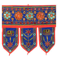 red and blue embroidery toran with mirror work