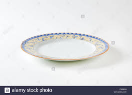 country style dinner plate with floral design border and brown
