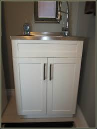 Laundry Room Utility Sink With Cabinet by Laundry Room Beautiful Cabinet Above Laundry Tub Image Of