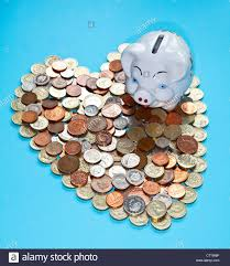 heart shaped piggy bank piggy bank with heart shaped change stock photo royalty