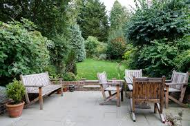 backyard patio and garden furniture in an english home stock