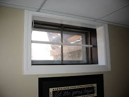 basement window blinds between glass cabinet hardware room