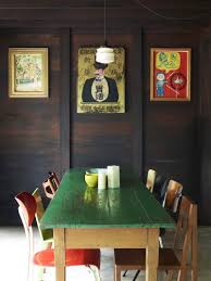 asian dining room ideas with wall art and wood paneling and