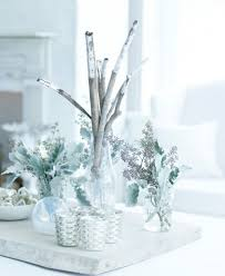17 white and silver decorations creating a snow