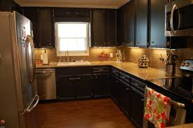 Kitchen Cabinet Stainless Steel Dark Kitchen Cabinets With Dark Countertops Yellow Pendant Lamps