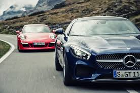 the new rivalry 2016 mercedes amg gt s vs 2015 porsche 911 gts