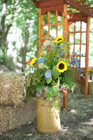 bright yellow sunflowers pale blue hydrangeas red crocosmia and