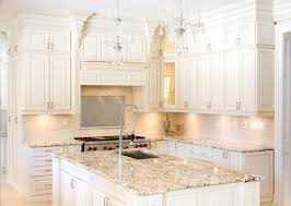 attractive white shaker kitchen cabinets with granite countertops