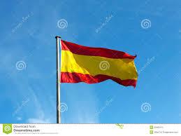 Flag Im Spanische Flagge Im Wind Gegen Den Himmel Stockfoto Bild Von