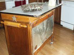 Repurposed Dresser Kitchen Island - old kitchen table and an old dresser made into a kitchen island