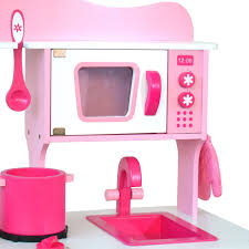boppi pink wooden toy kitchen 20 piece bopster boppi wooden toy kitchen close up sink and microwave