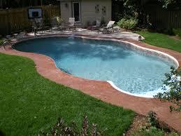 16x32 sierra inground pool with reddish stamped concrete