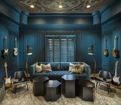 this glamorous dark teal media room was completed by imi design