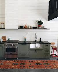 bead board kitchen cabinets appliances green kitchen cabinetry set with black holder