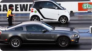 lamborghini vs smart car blown smart car outruns mustang epic drag race
