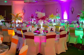 80 s theme pany party with ostrich feather centerpieces and