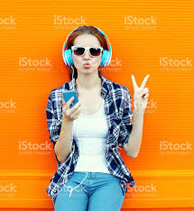Cool Stock by Pretty Cool Having Fun And Listens Music In Headphones Stock