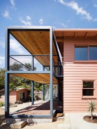productora adds steel frame extension to pink bungalow in los angeles