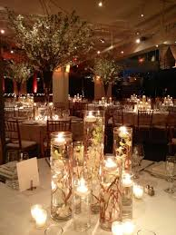 Floating Candle Centerpiece Ideas Cylinder Vases With Floating Candle Centerpiece And Submerged