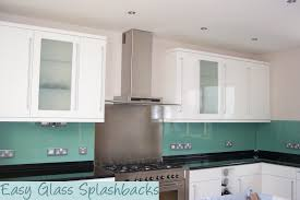White Kitchen Images Mint Green Coloured Glass Splashback In A White Kitchen With Black