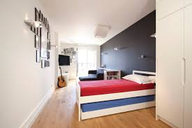bedroom simple room ideas for teenage guys with black wall behind