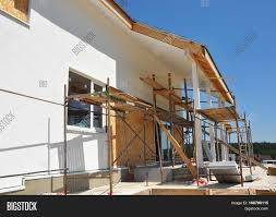 Painting House by Home Remodeling And Renovation Construction Or Repair Of The