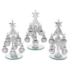 small silver glass trees with silver decorated baubles