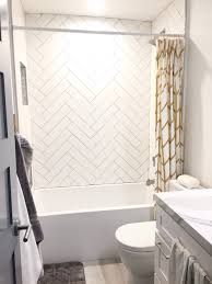 guest shower herringbone white subway tile gray grout gold twist subway tile for the kids bath herringbone white gray grout small bathroom
