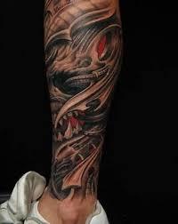 wonderful biomechanical design on leg tattooshunter com