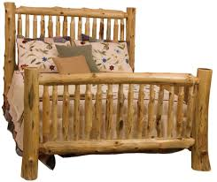 queen small spindle log bed with hand peeled logs by fireside
