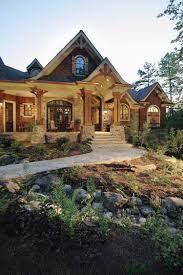 outside of the house stone and wood exterior i love this combo yes i have many