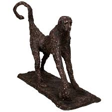 large sculpture of a baboon in the style of alberto giacometti for