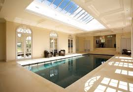 tips for indoor swimming pool design you have to know traba homes exciting transparent skylight combined with cool indoor swimming pool and comfortable arm chairs