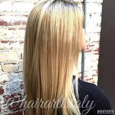 stretched root natural balayage dark blonde long layered haircut