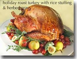 herb roasted turkey with wild turkey with rice stuffing u0026 gravy with fresh herbs