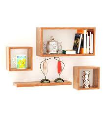 wall shelves pepperfry mango wood wall shelves set of 4 at rs 1099 shop online at